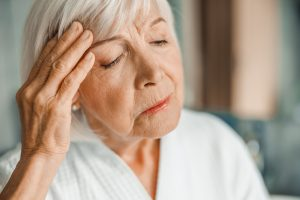 Close up of upset old woman suffering from migraine stock photo